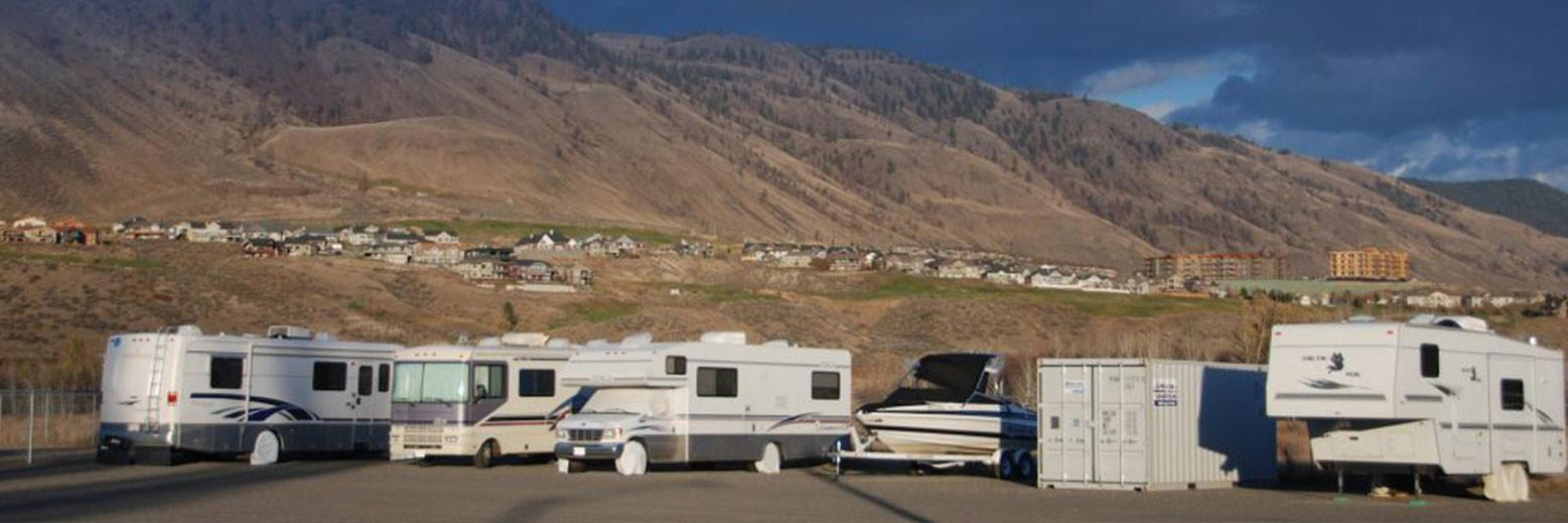 rv and boat storage in kamloops with mountain background
